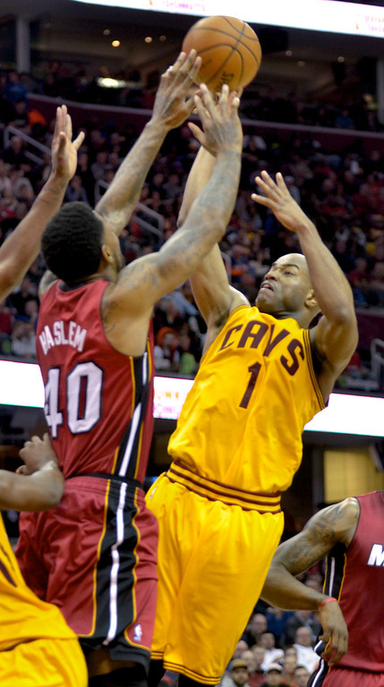 . Jeff Forman/JForman@News-Herald.com The Cavaliers\' Jarrett Jack shoots over Udonis Haslem during the second quarte March 18 at Quicken Loans Arena.