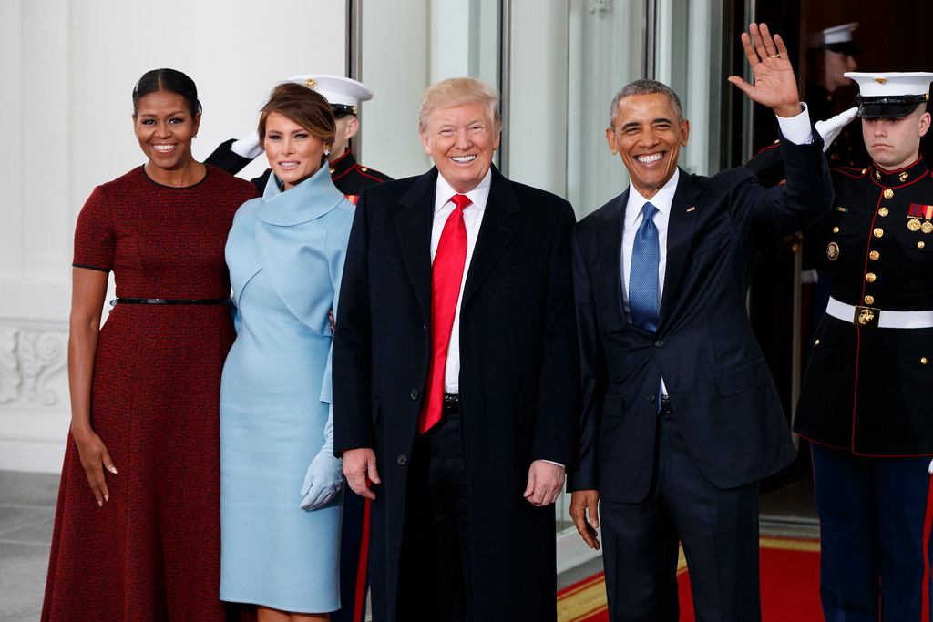 . President Barack Obama and first lady Michelle Obama stand with President-elect Donald Trump and his wife Melania Trump at the White House, Friday, Jan. 20, 2017, in Washington. (AP Photo/Evan Vucci)