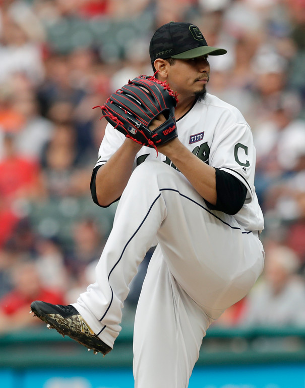 . Cleveland Indians starting pitcher Carlos Carrasco winds up during the first inning of the team\'s baseball game against the Houston Astros, Saturday, May 26, 2018, in Cleveland. (AP Photo/Tony Dejak)