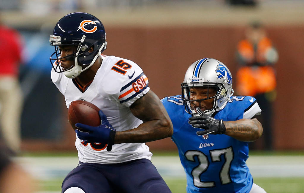 . Chicago Bears wide receiver Brandon Marshall (15) pulls away from Detroit Lions strong safety Glover Quin (27) during the first quarter of an NFL football game at Ford Field in Detroit, Sunday, Sept. 29, 2013. (AP Photo/Paul Sancya)
