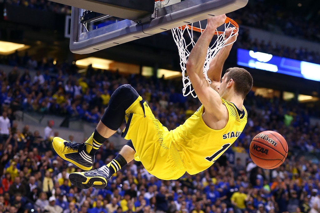 . Nik Stauskas #11 of the Michigan Wolverines dunks the ball over Dominique Hawkins #25 of the Kentucky Wildcats in the second half during the midwest regional final of the 2014 NCAA Men\'s Basketball Tournament at Lucas Oil Stadium on March 30, 2014 in Indianapolis, Indiana.  (Photo by Andy Lyons/Getty Images)