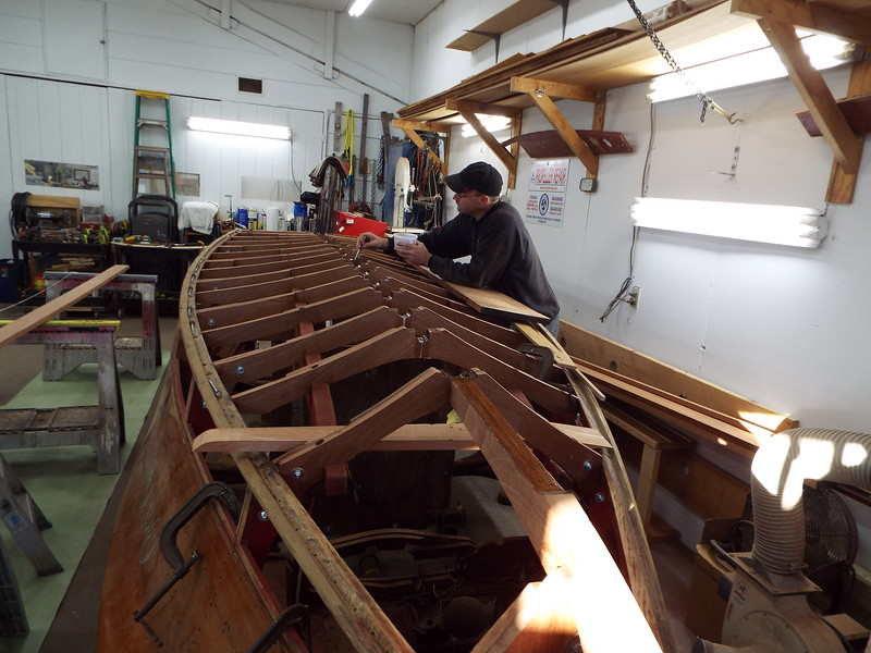 Epoxy being applied to the bottom frames where the keel will be installed.