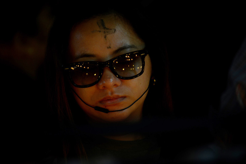 . A roman Catholic devotee lights candles at a church as the country marks Ash Wednesday, the official beginning of the Christian Lenten season in Manila on February 5, 2014. The ash symbolizes the mortality of human beings, of bodies disintegrating to ash after one dies. The Philippines is Asia\'s bastion of Catholicism, with over 80 percent of the about 100 million population belonging to the faith. (JAY DIRECTO/AFP/Getty Images)