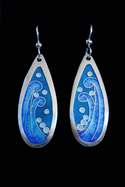Fine Silver Champlevé and Cloisonné teardrop wave pattern.  Approximately 1 5/8 inches long by 5/8 inches wide. Drop from earwire is approximately 2 1/8 inches. Sterling Silver earwires. 110.00