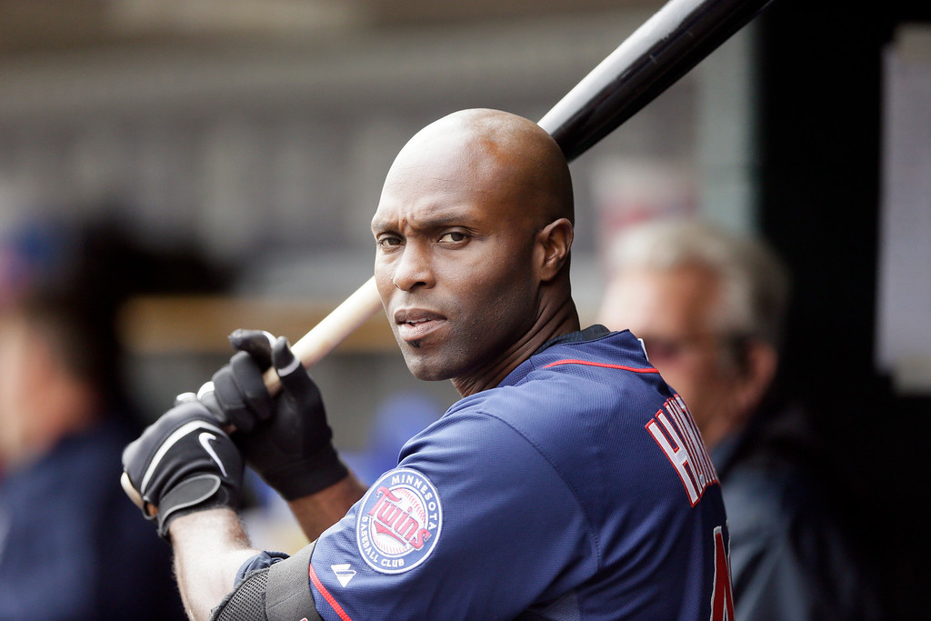 . Minnesota Twins right fielder Torii Hunter is seen in the dugout during the sixth inning of an opening day baseball game against the Detroit Tigers in Detroit, Monday, April 6, 2015. (AP Photo/Carlos Osorio)