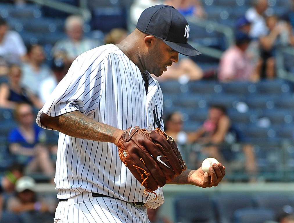 . Yankees starting pitcher C.C. Sabathia reacts on the mound after he misplayed a soft pop-up by Minnesota\'s Justin Morneau, allowing a runner to score in the fourth inning. (AP Photo/Kathy Kmonicek)