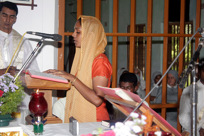 Sindhu, Br. Sajeevan's sister, reads the first scripture reading.