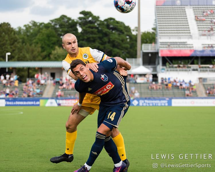 North Carolina FC forward Daniel Rios (14) and Nashville SC defender Liam Doyle (5)