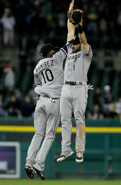 . Chicago White Sox\'s Alexei Ramirez celebrates with Adam Eaton after a 11-4 win over the Detroit Tigers in a baseball game Tuesday, July 29, 2014, in Detroit. (AP Photo/Duane Burleson)