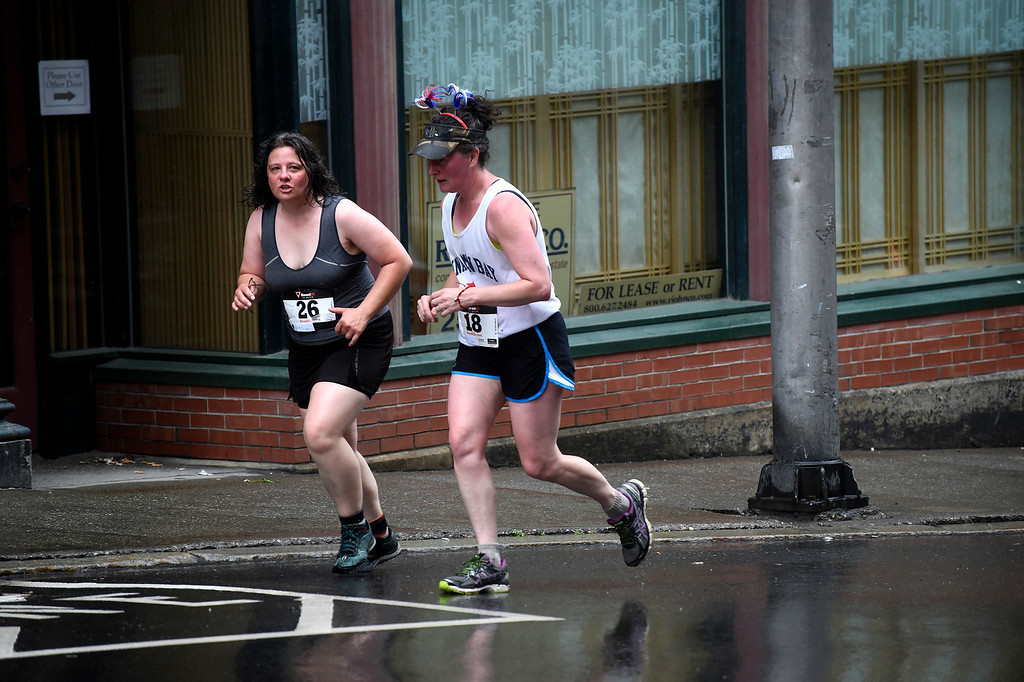 . Kayla Rice/Reformer Women run up Main St. in Brattleboro while running in the Bill Powers Memorial Firecracker 4-Miler on Friday morning.