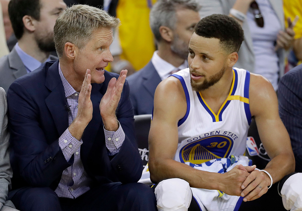 . Golden State Warriors head coach Steve Kerr, left, talks with guard Stephen Curry during the second half of Game 2 of basketball\'s NBA Finals against the Cleveland Cavaliers in Oakland, Calif., Sunday, June 4, 2017. (AP Photo/Marcio Jose Sanchez)