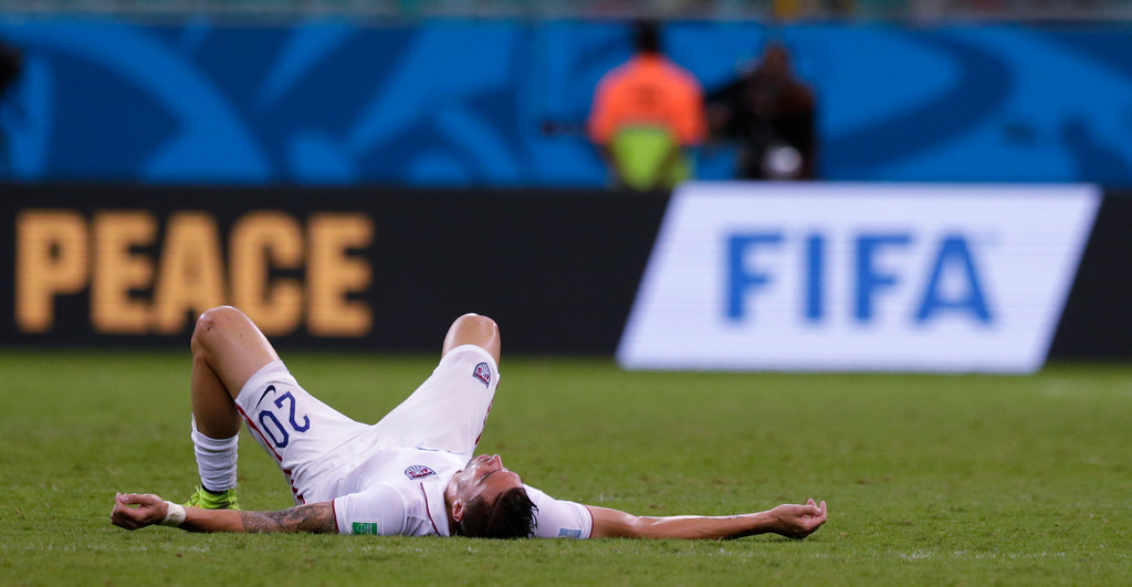 . United States\' Geoff Cameron lays on the pitch after the World Cup round of 16 soccer match between Belgium and the USA at the Arena Fonte Nova in Salvador, Brazil, Tuesday, July 1, 2014. Belgium won the match 2-1 after extra-time.  (AP Photo/Julio Cortez)