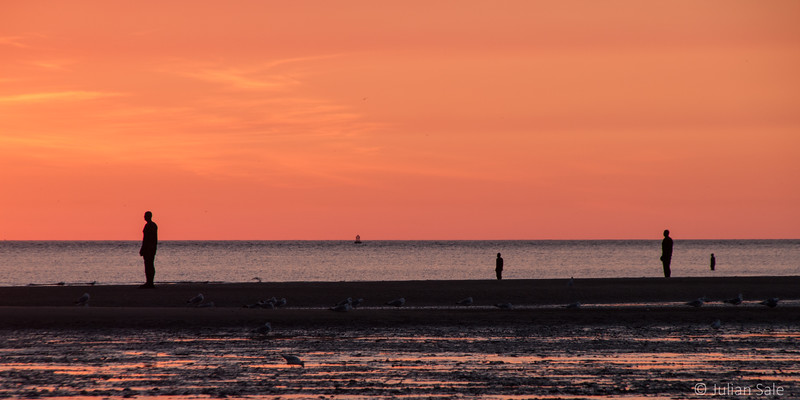 Anthony Gormley's Another Place with 4 life sized cast iron statues