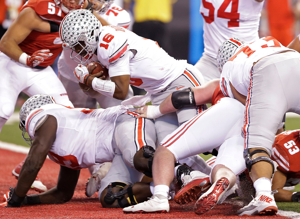 . Ohio State quarterback J.T. Barrett goes in for a 1-yard touchdown run during the first half of the Big Ten championship NCAA college football game against Wisconsin, Saturday, Dec. 2, 2017, in Indianapolis. (AP Photo/AJ Mast)