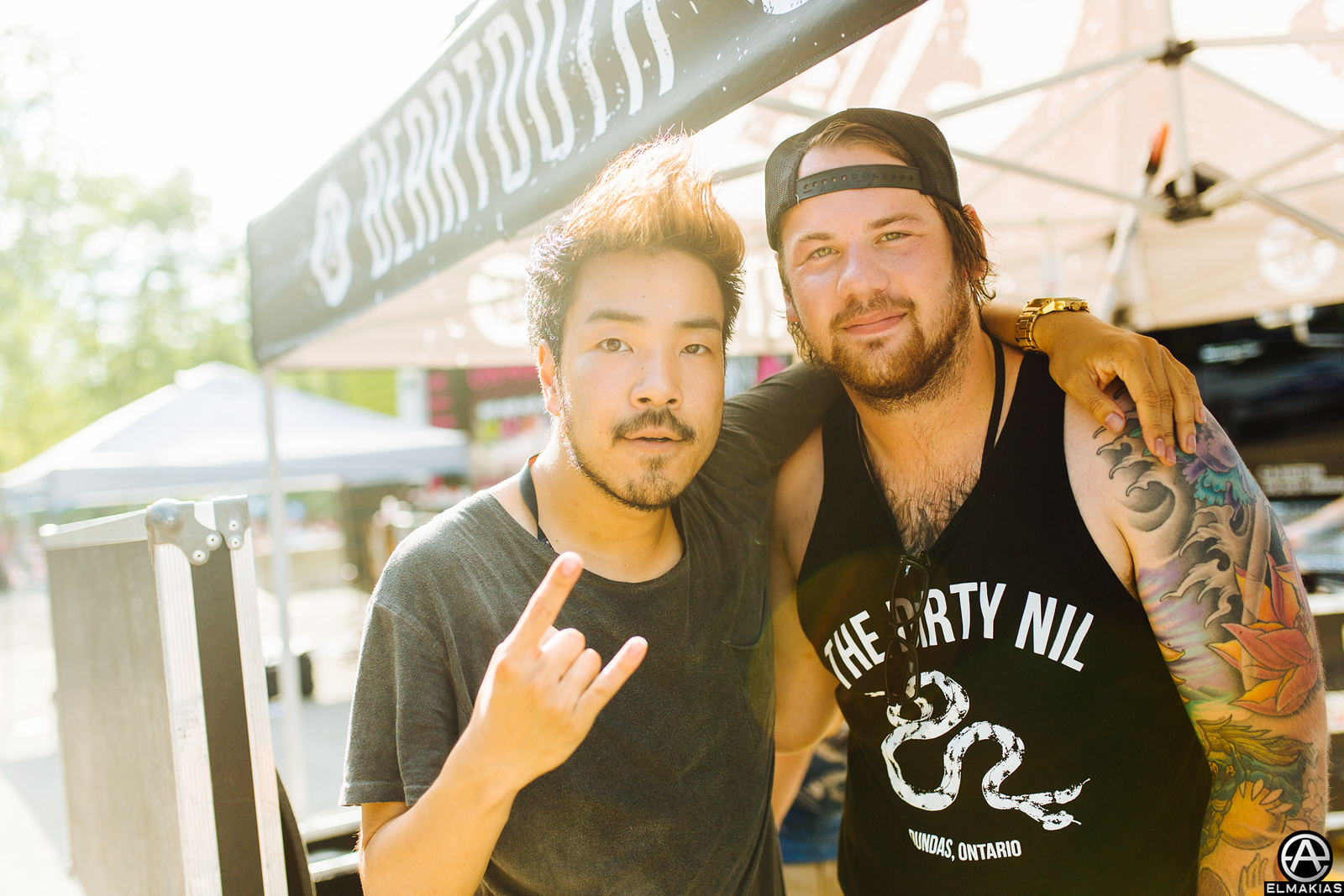 Kenta Koie of Crossfaith and Caleb Shomo of Beartooth at Vans Warped Tour 2015 by Adam Elmakias