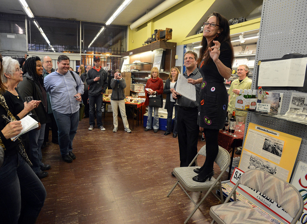 . Laura Sarber, right, gives a speech during a farewell event for Sarber\'s Cameras in Oakland, Calif., on Friday, Feb. 1, 2013. The store was bought in 1961 by Peter and Nancy Sarber and moved to Montclair in 1964. After more than a half-century in business, Sarber\'s Cameras is closing. The Sarber family held the farewell event for longtime customers, friends and family in Montclair Village. (Doug Duran/Staff)