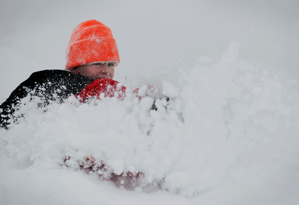 . Aidan Zerr, 8, sleds down a hill on Feb. 24 in Littleton, Colo. Photo by Jamie Cotten, Special to The Denver Post