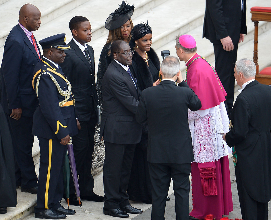 . Zimbabwe\'s President Robert Mugabe and his wife Grace Mugabe arrive for the canonisation mass of Popes John XXIII and John Paul II on St Peter\'s at the Vatican on April 27, 2014. Catholics from around the world gathered in Rome on Sunday for a mass presided by Pope Francis to confer sainthood on John Paul II and John XXIII -- two influential popes who helped shape 20th century history.    AFP PHOTO / VINCENZO PINTO