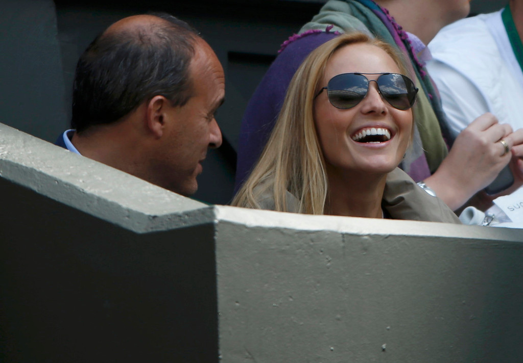 . Jelena Ristic, the girlfriend of Novak Djokovic of Serbia, sits on Centre Court for Djokovic\'s men\'s singles tennis match against Florian Mayer of Germany at the Wimbledon Tennis Championships, in London June 25, 2013.      REUTERS/Eddie Keogh