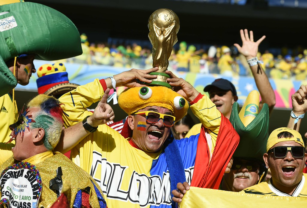 . TOPSHOTS  Brazil\'s supporters cheer prior to the quarter-final football match between Brazil and Colombia at the Castelao Stadium in Fortaleza during the 2014 FIFA World Cup on July 4, 2014.    AFP PHOTO / FABRICE COFFRINIFABRICE COFFRINI/AFP/Getty Images