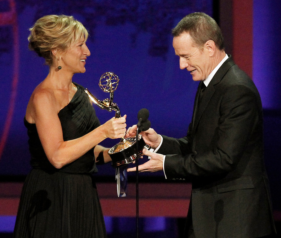 """. Edie Falco presents Bryan Cranston with the award for outstanding lead actor in a drama series for \""""Breaking Bad\"""" during the 62nd Primetime Emmy Awards Sunday, Aug. 29, 2010, in Los Angeles. (AP Photo/Chris Carlson)"""