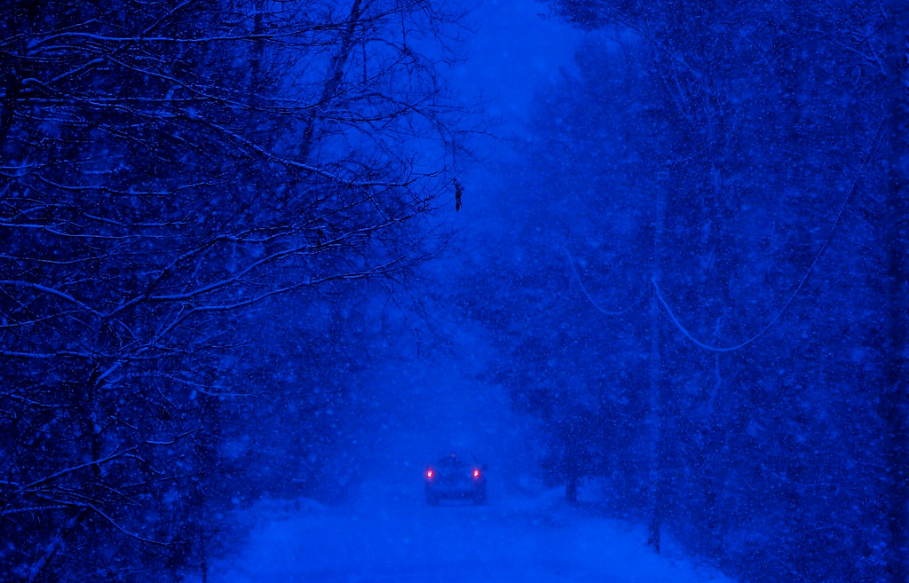 . A motorist drives through a snow storm in Durham, Maine, Thursday, Dec. 29, 2016. A nor\'easter is expected to drop 12 to 18 inches of snow on parts of Maine, according to the National Weather Service. (AP Photo/Robert F. Bukaty)