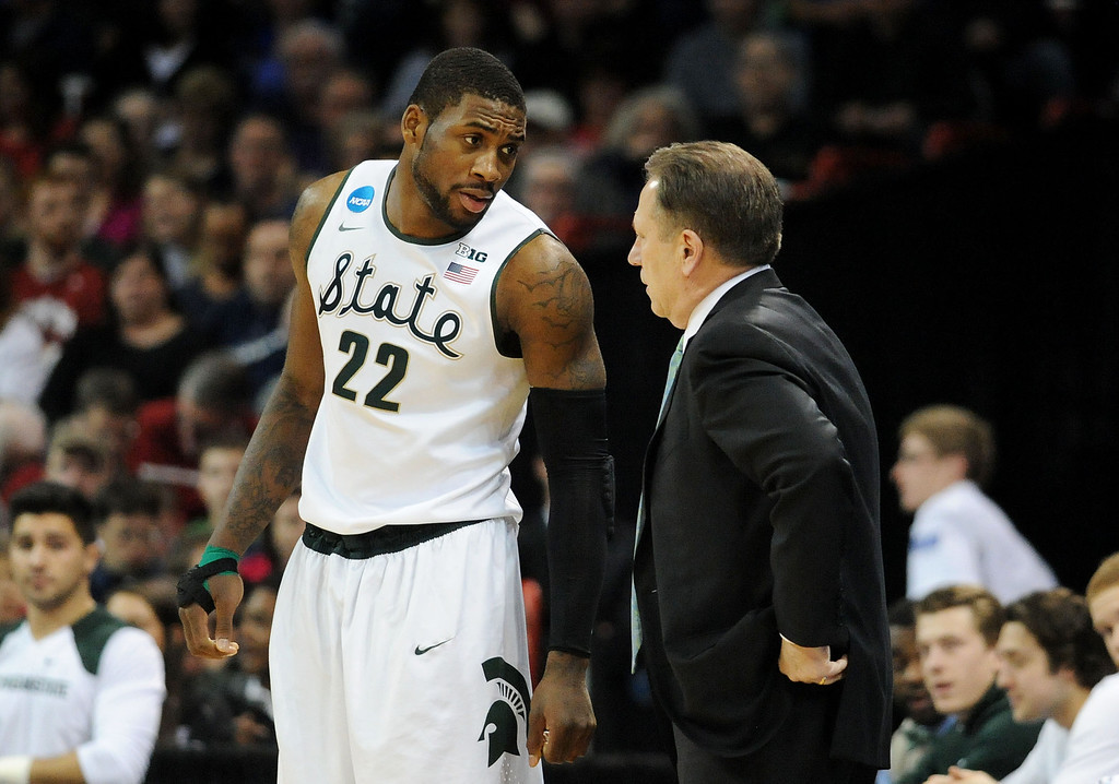 . SPOKANE, WA - MARCH 22:  Head coach Tom Izzo talks to Branden Dawson #22 of the Michigan State Spartans in the first half against the Harvard Crimson during the Third Round of the 2014 NCAA Basketball Tournament at Spokane Veterans Memorial Arena on March 22, 2014 in Spokane, Washington.  (Photo by Steve Dykes/Getty Images)