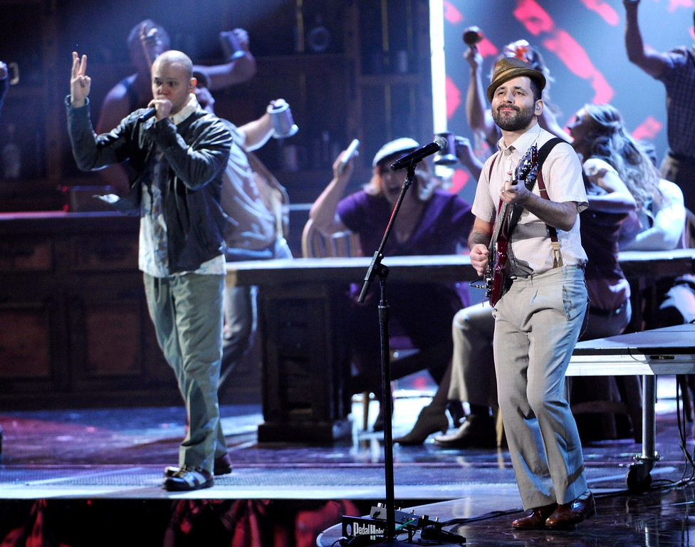 """. Rene Perez Joglar, left, and Eduardo \""""Visitante\"""" Cabra, of the musical group Calle 13, perform on stage at the 15th annual Latin Grammy Awards at the MGM Grand Garden Arena on Thursday, Nov. 20, 2014, in Las Vegas. (Photo by Chris Pizzello/Invision/AP)"""