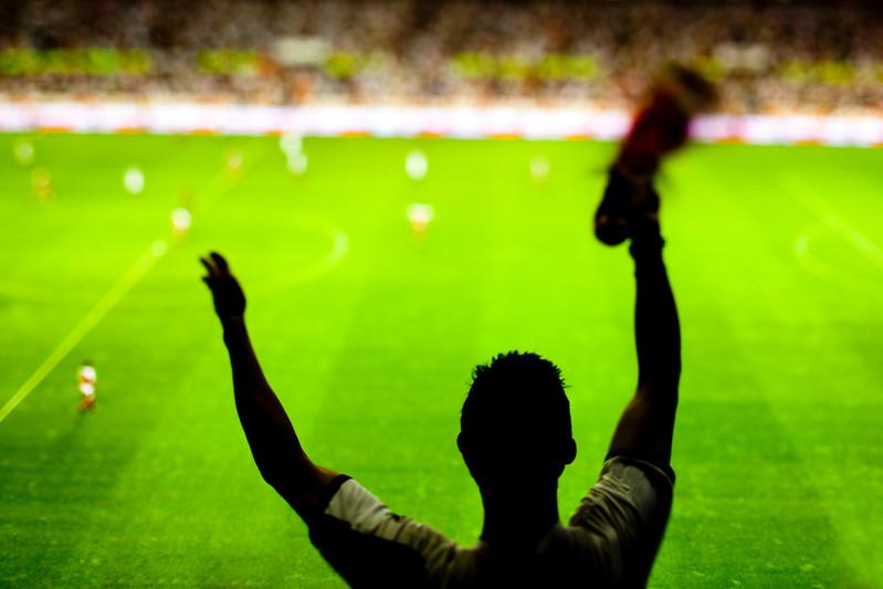 Football fan cheering his team at the stadium, Spain.