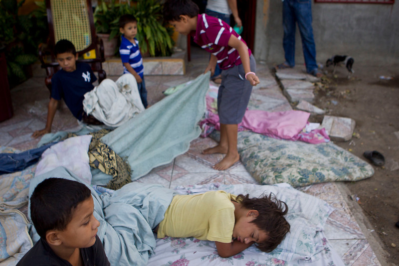 . Children lie on a mattress outside their home after a strong earthquake in Nagarote, Nicaragua, Friday, April 11, 2014. Nicaragua\'s President Daniel Ortega declared red alert Friday after an earthquake of 6.2 magnitude on the Richter scale that shook the country on Thursday and left one dead, damaged hundreds of houses and left thousands of people affected . (AP Photo/Esteban Felix)
