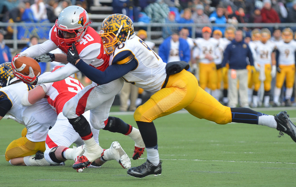 . Michael Allen Blair/ MBlair@News-Herald.com Mentor wide receiver Eddie Daugherty runs in for a touchdown after the catch as Cincinnati Moeller\'s Cody Mackey can\'t make the tackle during the second quarter of Saturday\'s Div. I state championship game at Fawcett Stadium in Canton.