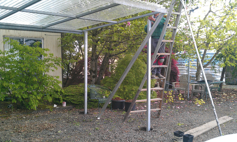 Isidro building our new picnic table cover.