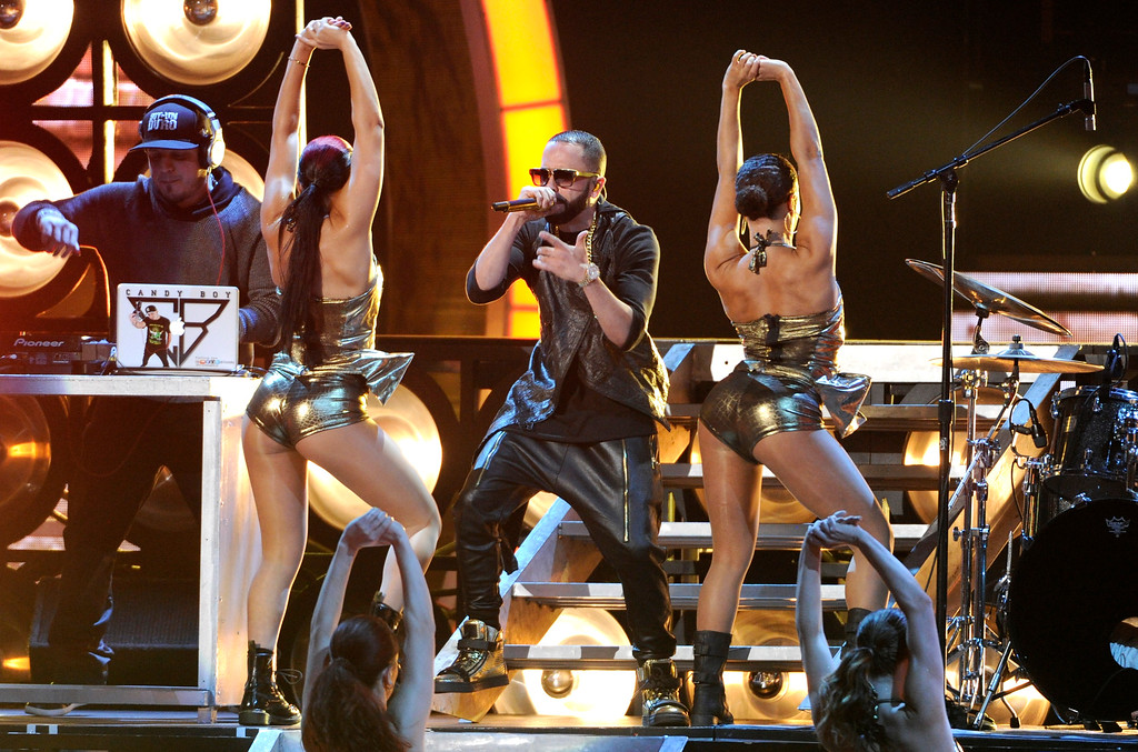 . Yandel performs at the 15th annual Latin Grammy Awards at the MGM Grand Garden Arena on Thursday, Nov. 20, 2014, in Las Vegas. (Photo by Chris Pizzello/Invision/AP)