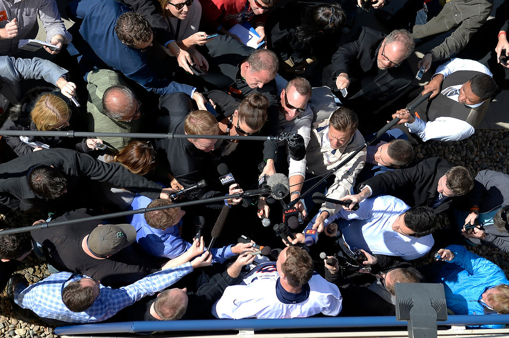 . Denver Broncos quarterback Peyton Manning is surrounded by media for his press conference after practice on October 16, 2013 at Dove Valley. (Photo by John Leyba/The Denver Post)