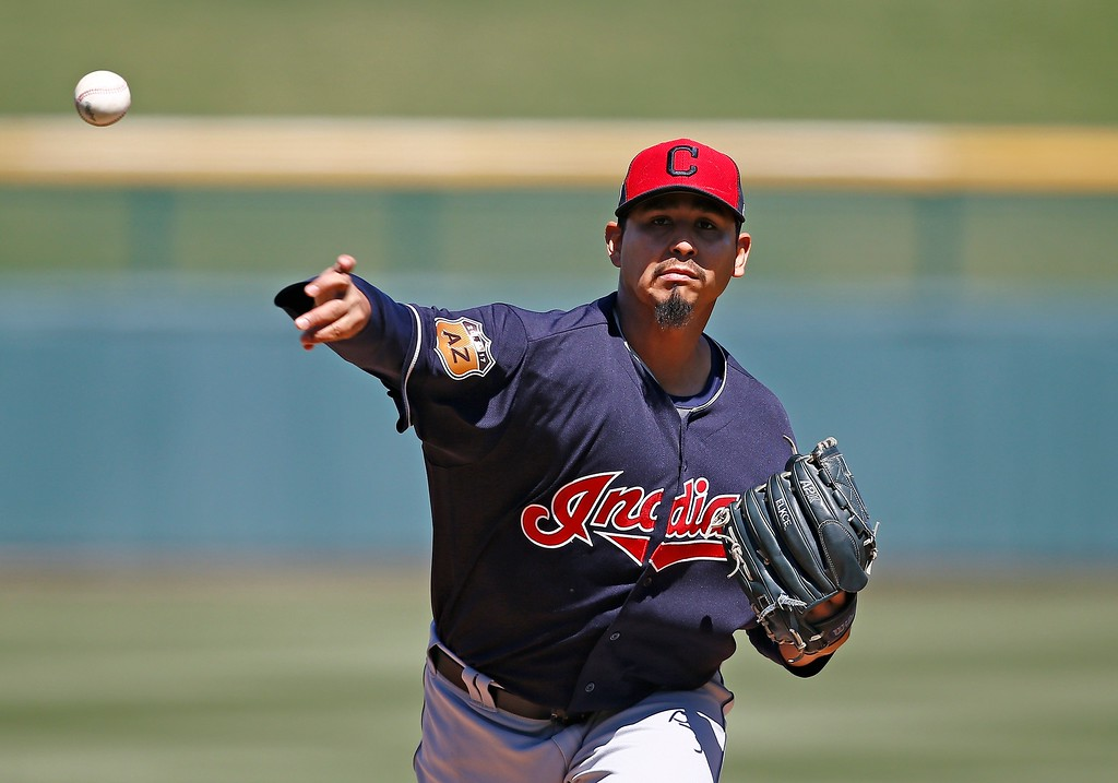 . Cleveland Indians starting pitcher Carlos Carrasco warms up during the first inning of a spring training baseball game against the Chicago Cubs Friday, March 24, 2017, in Mesa, Ariz. (AP Photo/Ross D. Franklin)