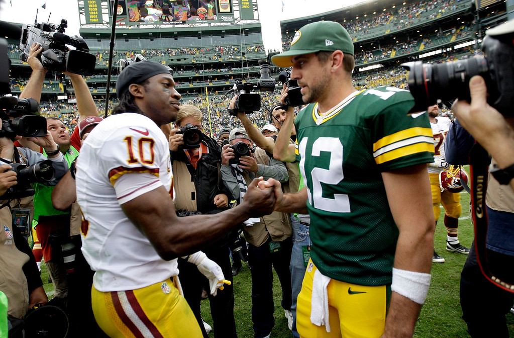 . Green Bay Packers\' Aaron Rodgers and Washington Redskins\' Robert Griffin III greet each other after the game at Lambeau Field in Green Bay, Wisconsin, on Sunday, September 15, 2013. (Mike De Sisti/Milwaukee Journal Sentinel/MCT)