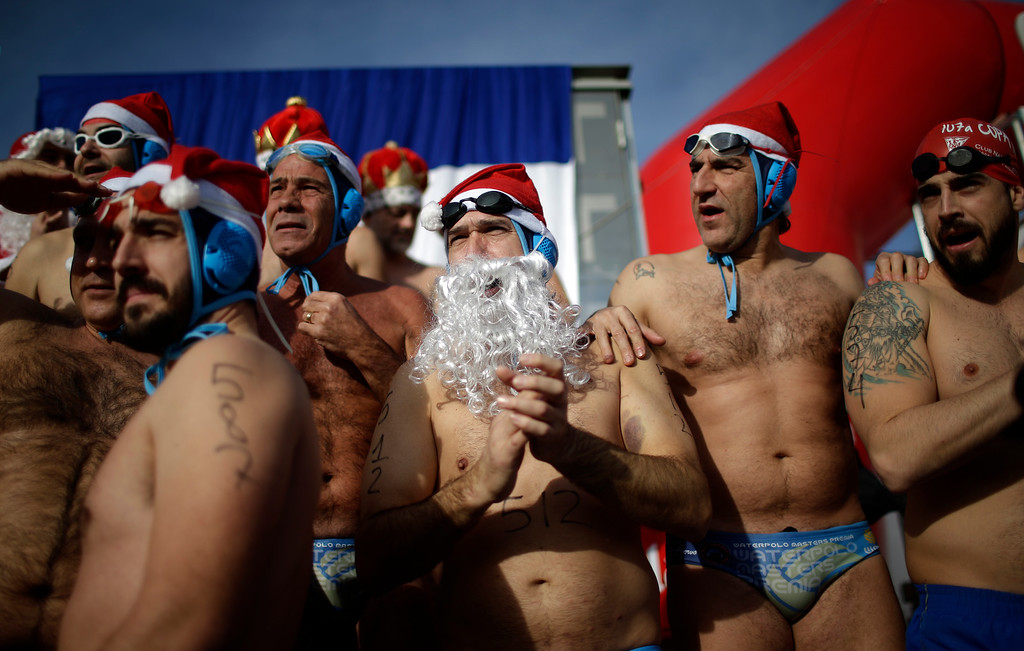 . People wearing fancy dress clothes prepare to jump into the Mediterranean sea as they take part in the Copa Nadal in the Spanish port of Barcelona, Sunday, Dec. 25, 2016. The Copa Nadal (Christmas Cup) is a traditional swimming competition that takes place in Barcelona every December 25th, where participants swim 200 meters in the open sea in the port of Barcelona. (AP Photo/Manu Fernandez)