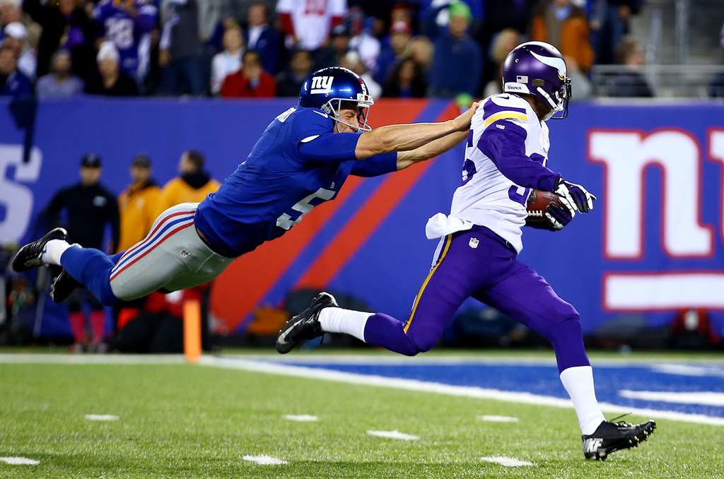 . Giants Punter Steve Weatherford tries to tackle Vikings cornerback Marcus Sherels as he returns a punt 86 yards for a touchdown in the first quarter.  (Photo by Al Bello/Getty Images)