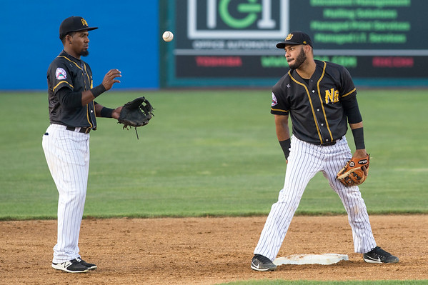 07/01/19 Wesley Bunnell | Staff The New Britain Bees vs the Somerset Patriots on Monday July 1, 2019. Jonathan Galvez (10) takes the throw from the catcher during warmups and tosses it to Random Moreno (4).