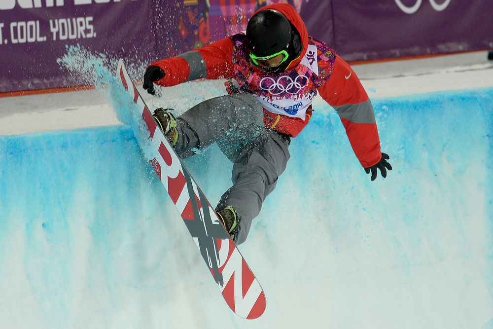 . China\'s Shi Wancheng hits the lip during the men\'s snowboard halfpipe final. Sochi 2014 Winter Olympics on Tuesday, February 11, 2014. (Photo by AAron Ontiveroz/The Denver Post)