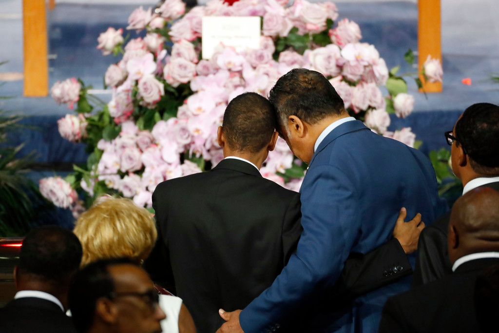 . Rev. Jesse Jackson, right, consoles a family member as they pause at the casket of Aretha Franklin during her funeral service at Greater Grace Temple, Friday, Aug. 31, 2018, in Detroit. Franklin died Aug. 16, 2018 of pancreatic cancer at the age of 76. (AP Photo/Paul Sancya)