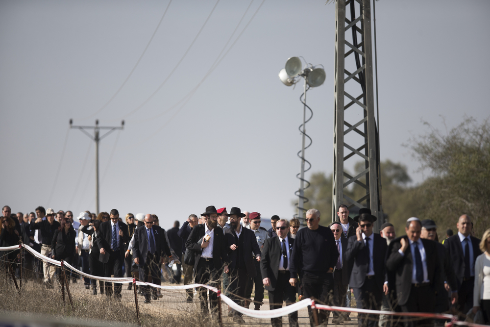 . Israelis arrive to the funeral ceremony of former Prime Minister Ariel Sharon on January 13, 2014 in Havat Hashikmim, Israel. Former PM Ariel Sharon\'s died on Saturday aged 85 in Tel Hashomer hospital near Tel Aviv and had been in a coma since January 4, 2006. (Photo by Uriel Sinai/Getty Images)
