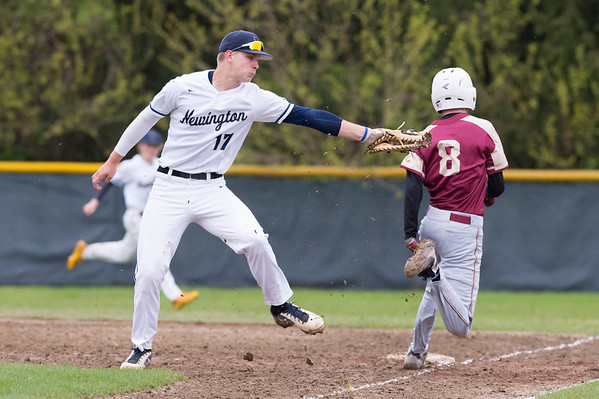 05/14/19 Wesley Bunnell | Staff Newington baseball defeated New Britain 4-3 in a walk off on Tuesday afternoon at Newington High School. Newington's Zach Nakonechny (17) is pulled off the base on a close play.