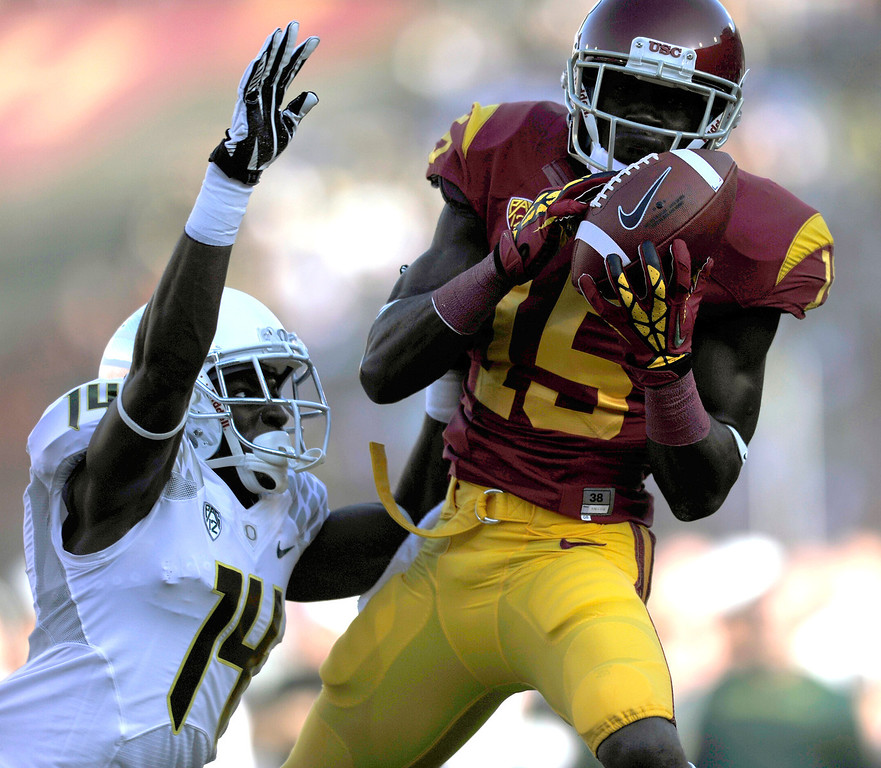 . USC WR Nelson Agholor hauls in a first-quarter pass that Oregon\'s Ifo Ekpre-Olomu strips for an incomplete pass in the end zone Saturday, November 3, 2012, at the L.A. Memorial Coliseum. (Michael Owen Baker/L.A. Daily News)