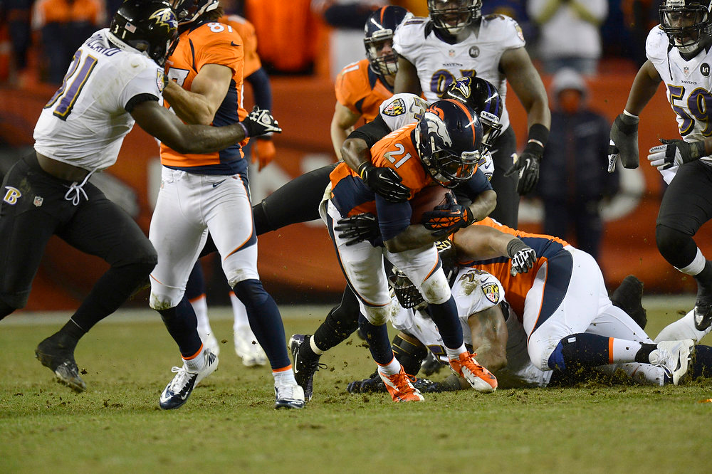 . Denver Broncos running back Ronnie Hillman (21) picks up a first down with two minutes left in the game. The Denver Broncos vs Baltimore Ravens AFC Divisional playoff game at Sports Authority Field Saturday January 12, 2013. (Photo by Joe Amon,/The Denver Post)
