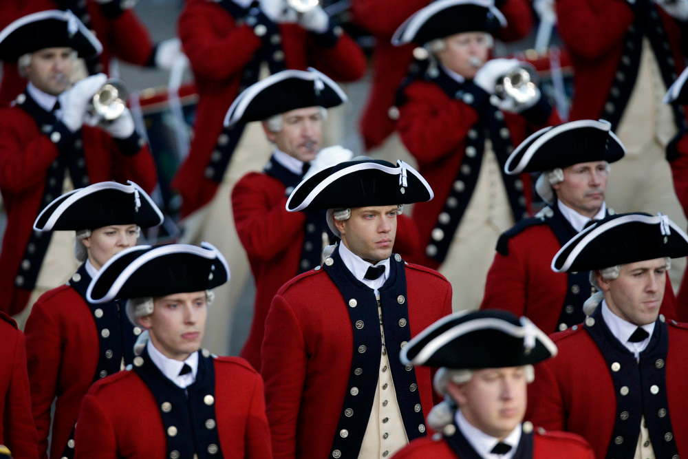 . The Army\'s Old Guard Fife and Drum Corps walks down Pennsylvania Avenue en route to the White House, Monday, Jan. 21, 2013, in Washington. Thousands  marched during the 57th Presidential Inauguration parade after the ceremonial swearing-in of President Barack Obama. (AP Photo/Charlie Neibergall)