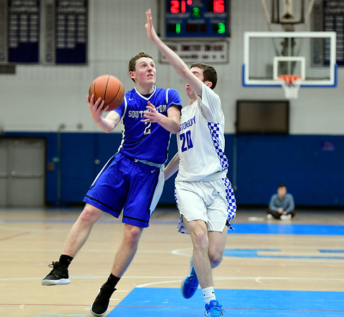 3/6/2019 Mike Orazzi | Staff Southington's Ryan Gesnaldo (2) and Glastonbury's Thomas Shea (20) during Wednesday night's Division II Second Round State Boys Basketball Tournament with at Glastonbury High School.