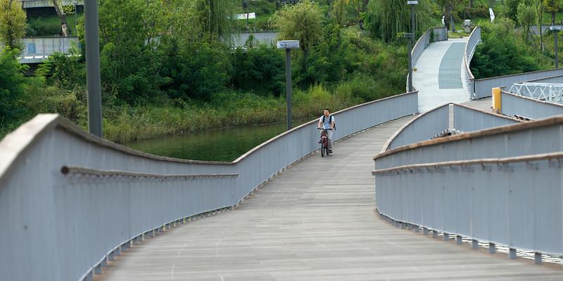 Man cycling on bridge, Seoul, South Korea