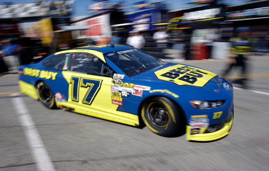 . Ricky Stenhouse Jr. returns to his garage during practice for the NASCAR Daytona 500 Sprint Cup Series auto race at Daytona International Speedway, Wednesday, Feb. 20, 2013, in Daytona Beach, Fla. (AP Photo/John Raoux)