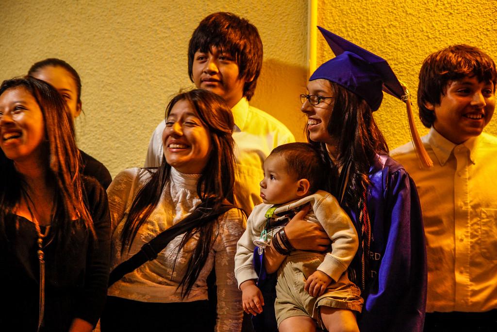 . The family of Jasmin Lucero Aquino surround her as Jasmin holds a future graduate, at John H Francis Polytechnic High School, Sun Valley, Calif., June 7, 2013. Photo: Lynn Levitt.
